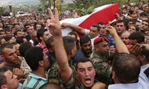 A Lebanese soldier among mourners at the funeral of beheaded soldier Ali al-Sayyed in Fnaydek