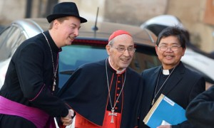 Ralph Napierski (L), a fake bishop poses