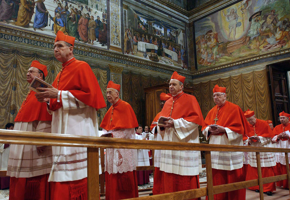 Cardinals enter the Sistine Chapel at th