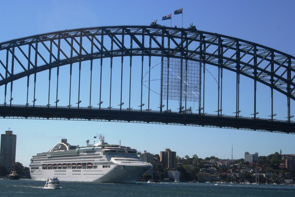 Harbor Bridge Sydney with huge passenger voyage ship