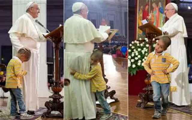 Boy hugs Pope(1)