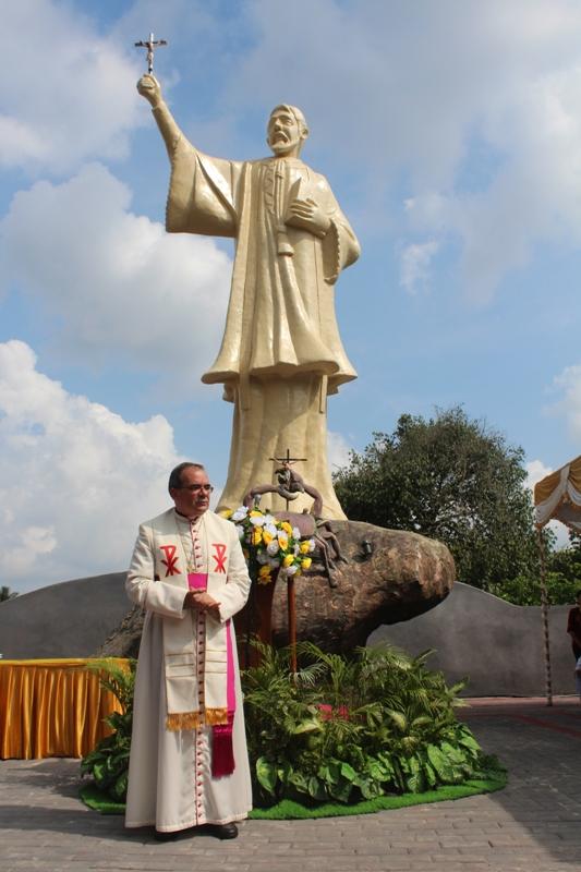 Vatican nuncio in front of st francis xavier statue