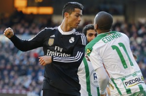 Real Madrid's Ronaldo scuffles with Cordoba's Fraga during their Spanish First Division soccer match at El Arcangel stadium in Cordoba
